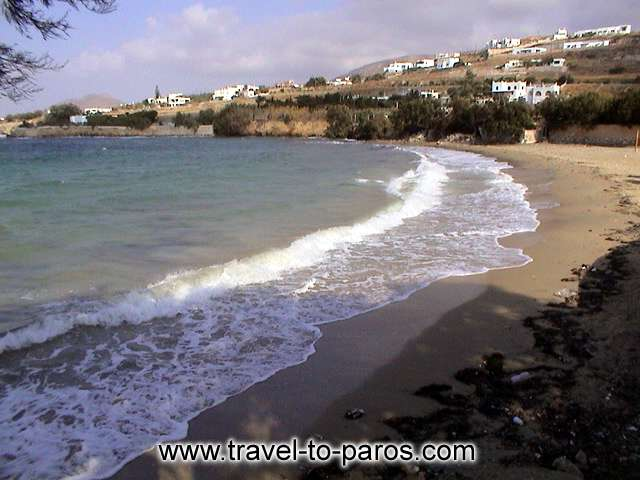 PARASPOROS BEACH - The clean light blue waters and the golden sands characterize the Parasporos beach.