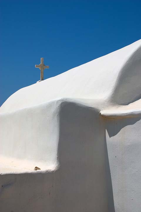 BLUE, WHITE AND A CROSS - A little chappel in the middle of nowhere in Paros. Just a part of it to show its simple form.