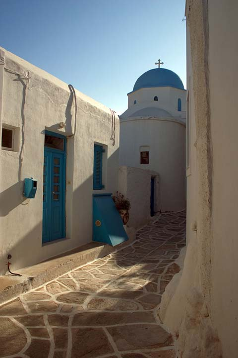 WHITE AND BLUE - A peaceful stroll among the medieval streets of a Greek Island village can lead to chapels like this. I love the afternoon sun, the soft playful light and the shades the buildings create. The chapel can be found on Paros island in a vilage called Lefkes.