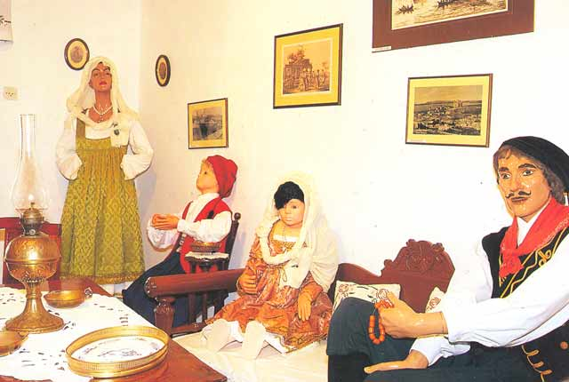 "TRADITIONAL COSTUME - The Medieval costumes of Paros that exhibited in the ""Folklore Collection Museum""."